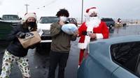 Fernando with Santa and Elf